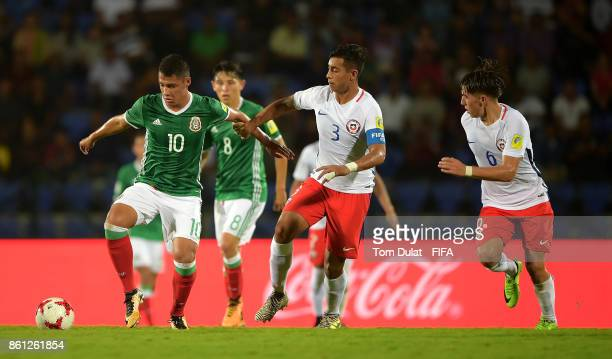 Roberto De La Rosa of Mexico and Lucas Alarcon of Chile in action during the FIFA U17 World Cup India 2017 group E match between Mexico and Chile at...