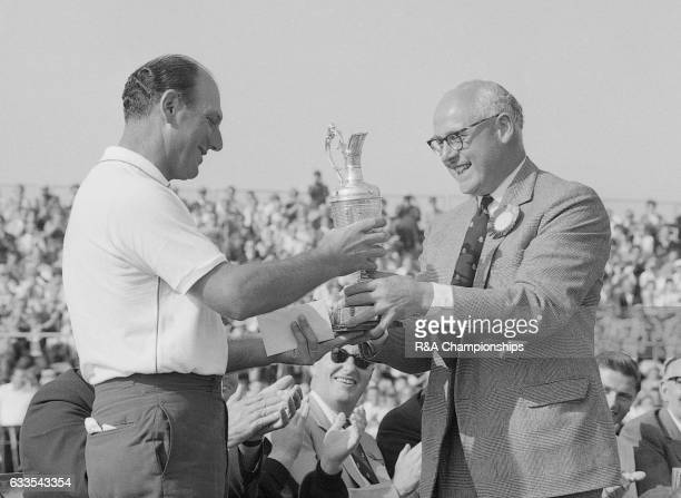 Roberto De Vicenzo of Argentina is presented with the Claret Jug after winning the 1967 Open Championship at Royal Liverpool Golf Club Hoylake England