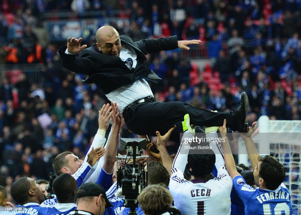 <a gi-track='captionPersonalityLinkClicked' href=/galleries/search?phrase=Roberto+Di+Matteo&family=editorial&specificpeople=2380083 ng-click='$event.stopPropagation()'>Roberto Di Matteo</a> caretaker manager of Chelsea is lifted by his players during the FA Cup with Budweiser Final match between Liverpool and Chelsea at Wembley Stadium on May 5, 2012 in London, England.