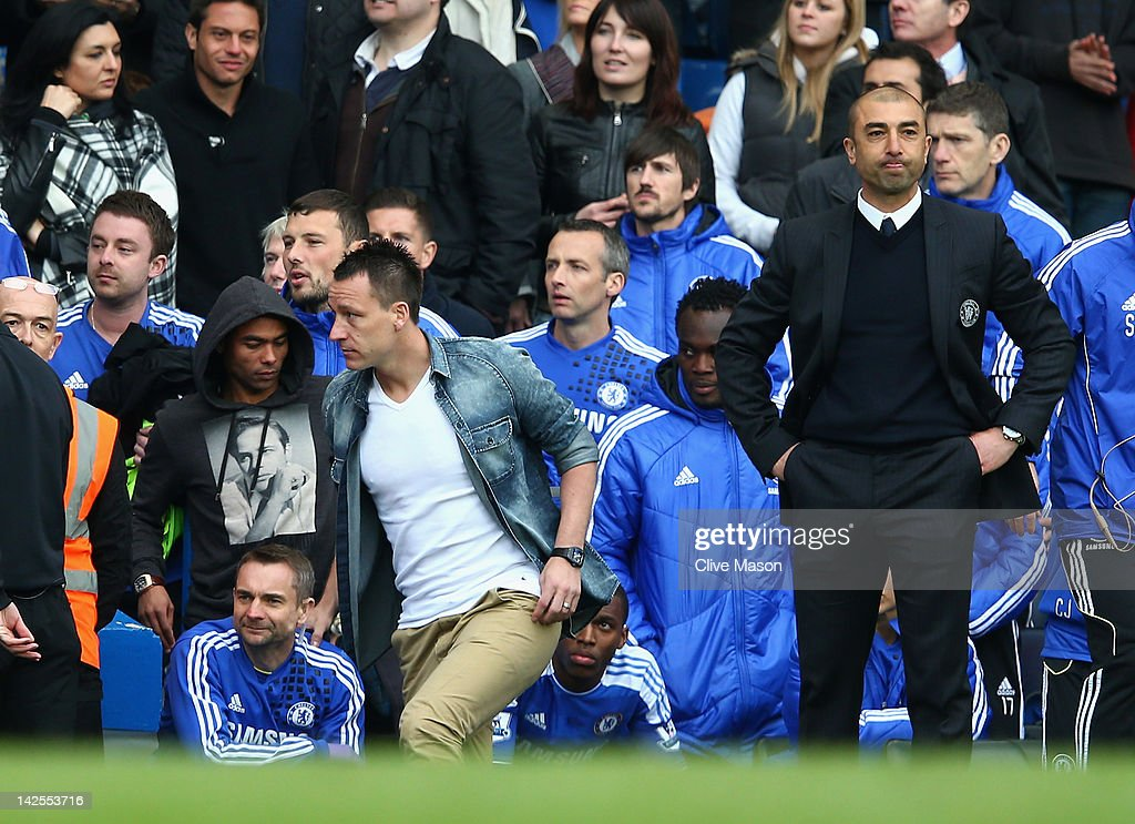 <a gi-track='captionPersonalityLinkClicked' href=/galleries/search?phrase=Roberto+Di+Matteo&family=editorial&specificpeople=2380083 ng-click='$event.stopPropagation()'>Roberto Di Matteo</a>, caretaker manager of Chelsea looks on as <a gi-track='captionPersonalityLinkClicked' href=/galleries/search?phrase=John+Terry&family=editorial&specificpeople=171535 ng-click='$event.stopPropagation()'>John Terry</a> and <a gi-track='captionPersonalityLinkClicked' href=/galleries/search?phrase=Ashley+Cole&family=editorial&specificpeople=201831 ng-click='$event.stopPropagation()'>Ashley Cole</a> walk towards the tunnel during the Barclays Premier League match between Chelsea and Wigan Athletic at Stamford Bridge on April 7, 2012 in London, England.