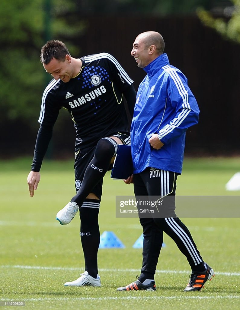 <a gi-track='captionPersonalityLinkClicked' href=/galleries/search?phrase=Roberto+Di+Matteo&family=editorial&specificpeople=2380083 ng-click='$event.stopPropagation()'>Roberto Di Matteo</a> caretaker manager of Chelsea shares a joke with <a gi-track='captionPersonalityLinkClicked' href=/galleries/search?phrase=John+Terry&family=editorial&specificpeople=171535 ng-click='$event.stopPropagation()'>John Terry</a> during training at Chelsea Training Ground on May 15, 2012 in Cobham, England.