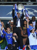 Roberto Di Matteo interim manager of Chelsea lifts the trophy in celebration after their victory in the UEFA Champions League Final between FC Bayern...
