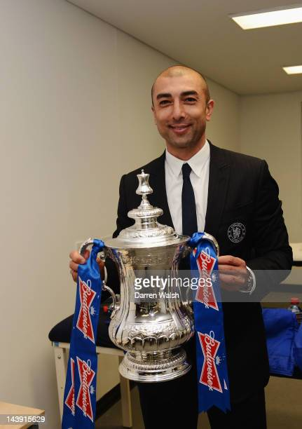 Roberto Di Matteo of Chelsea celebrates with the trophy in the dressing room after the FA Cup Final with Budweiser between Liverpool and Chelsea at...