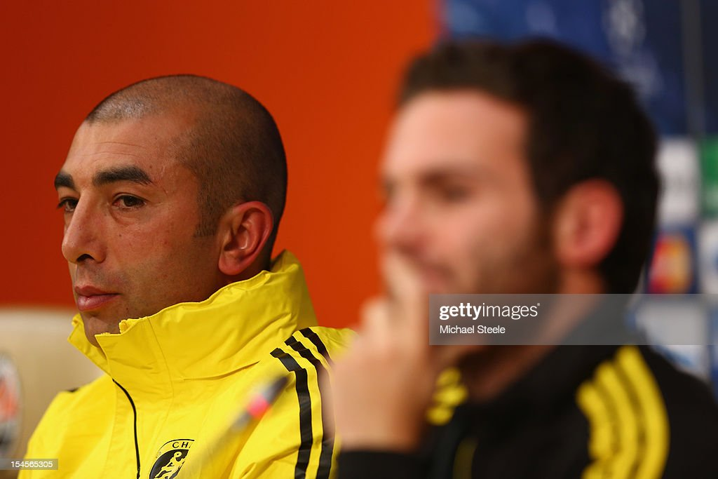 Roberto Di Matteo (L) the Chelsea manager alongside Juan Mata (R) during the Chelsea Training and Press Conference ahead of the UEFA Champions League Group E match between Shakhtar Donetsk and Chelsea at Donbass Arena on October 22, 2012 in Donetsk, Ukraine.