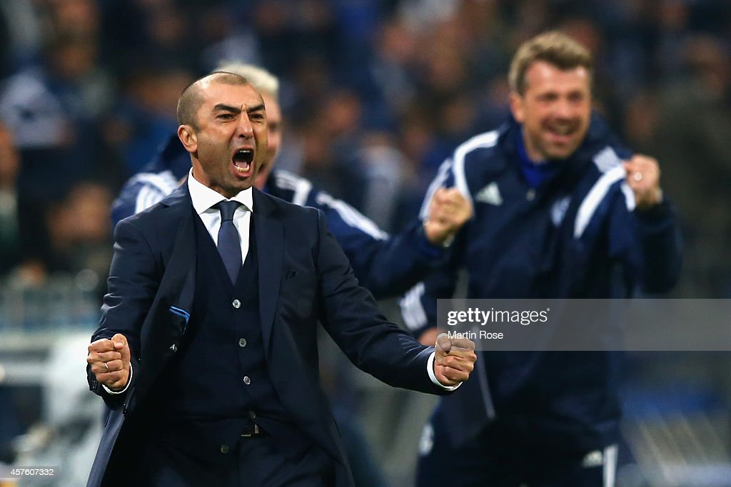 Roberto Di Matteo, the manager of Schalke celebrates after Chinedu Obasi of Schalke scores their first goal during the UEFA Champions League Group G match between FC Schalke 04 and Sporting Clube de Portugal at Veltins Arena on October 21, 2014 in Gelsenkirchen, Germany.
