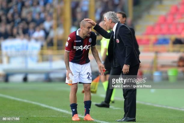 Roberto Donadoni head coach of Bologna FC talks to his player Rodrigo Palacio during the Serie A match between Bologna FC and Spal at Stadio Renato...
