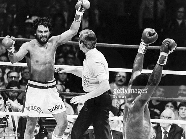 Roberto Duran raises his arms in defeat as Sugar Ray Leonard wins the fight in the 8th round and becomes the new welterweight champion