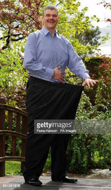 Roberto Enrieu inside his old trousers before he started slimming Mr Enrieu has been named Slimming World's Greatest Loser 2008 at Kensington Roof...