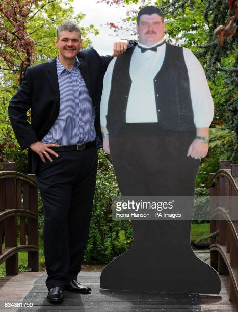 Roberto Enrieu with a life size cardboard cut out of himself before he started slimming Mr Enrieu has been named Slimming World's Greatest Loser 2008...