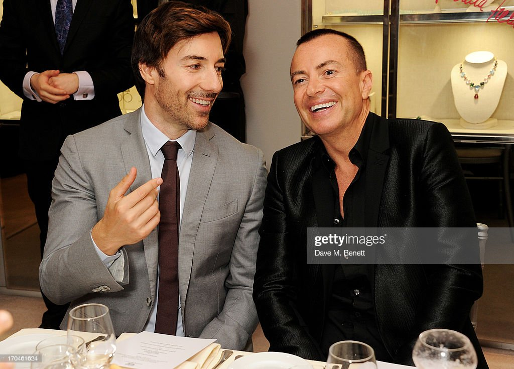 Roberto Faraone Mennella (L) and Julien Macdonald attend the 12th birthday of New York jewellery house Fararone Mennella, with guest of honour Patricia Field, at their Knightsbridge store on June 13, 2013 in London, England.