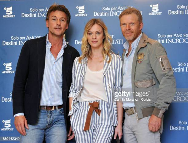 Roberto Farnesi Antonia Liskova and Kaspar Capparoni attend a photocall for 'Solo Per Amore Destini Incrociati' on May 8 2017 in Rome Italy