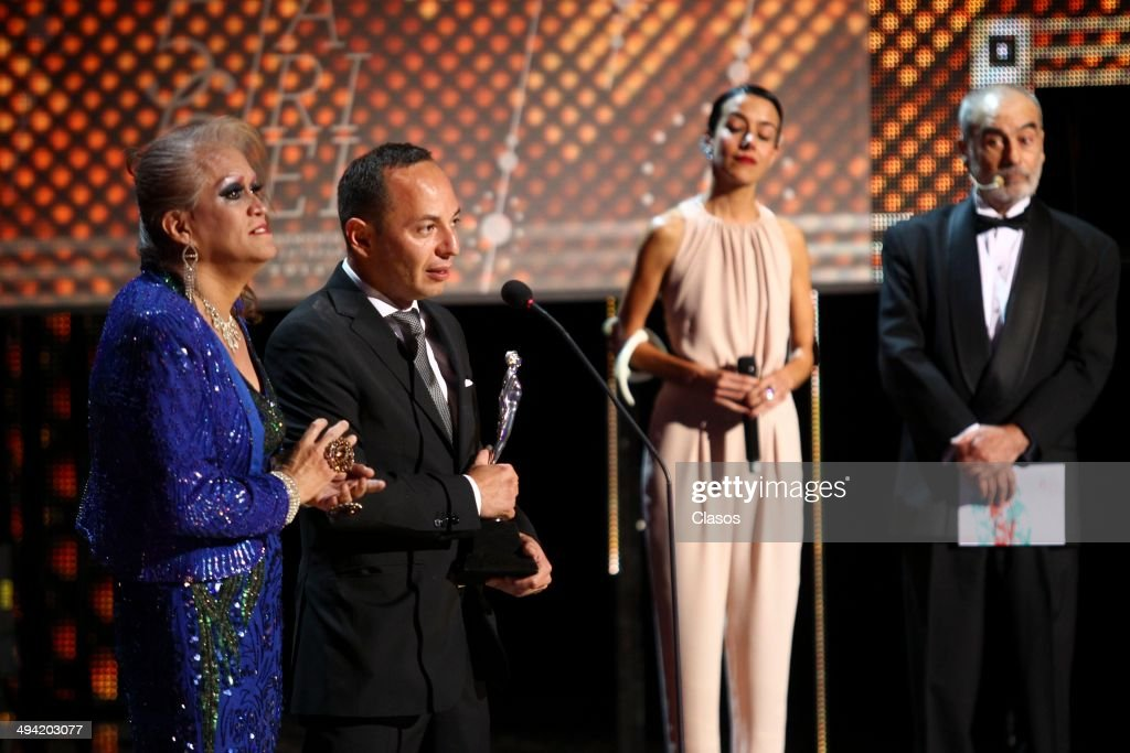Roberto Fiesco receives the Ariel award during the 56th Ariel Awards Ceremony at Palace of Fine Arts on May 27 2014 in Mexico City Mexico