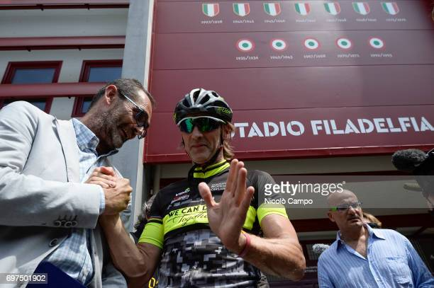Roberto Finardi assessor of Sport in Turin shakes hand with Davide Nicola Davide Nicola is the head coach of FC Crotone he took a bicycle trip from...