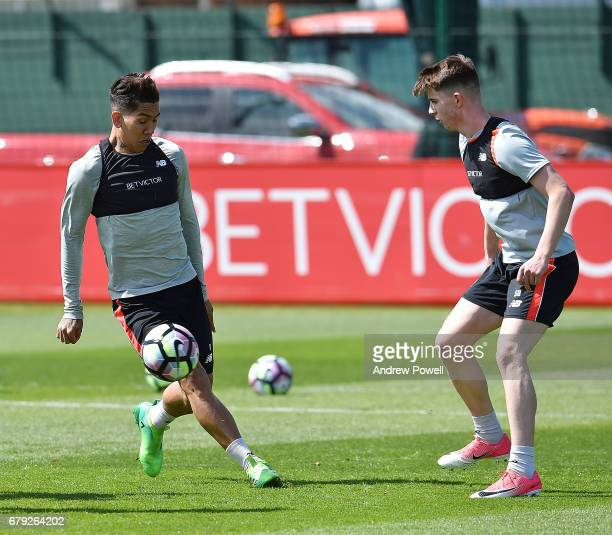 Roberto Firmino and Ben Woodburn of Liverpool during a training session at Melwood Training Ground on May 5 2017 in Liverpool England
