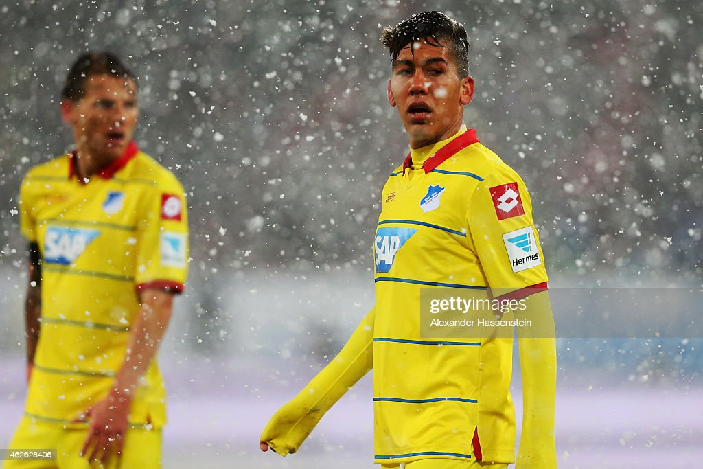 Roberto Firmino (front) and Eugen Polanski of Hoffenheim react during the Bundesliga match between FC Augsburg and 1899 Hoffenheim at SGL Arena on February 1, 2015 in Augsburg, Germany.