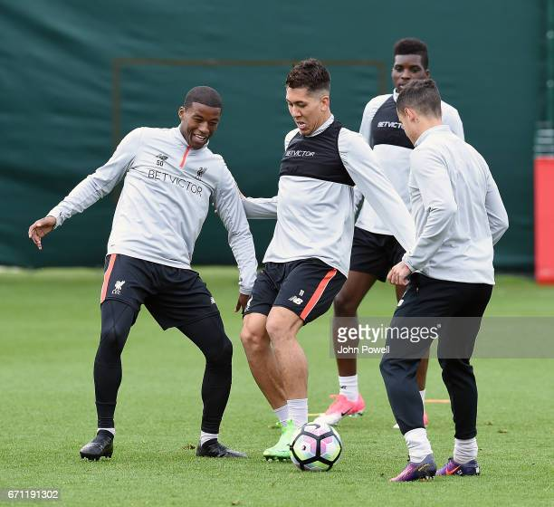 Roberto Firmino and Georginio Wijnaldum of Liverpool during a training session at Melwood Training Ground on April 21 2017 in Liverpool England