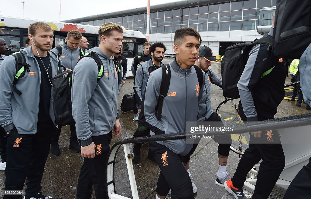 Roberto Firmino and Loris Karius of Liverpool boarding the plane at John Lennon Airport on September 25, 2017 in Liverpool, England.