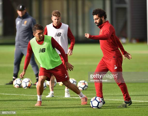 Roberto Firmino and Mohamed Salah of Liverpool during a training session at Melwood Training Ground on September 21 2017 in Liverpool United Kingdom