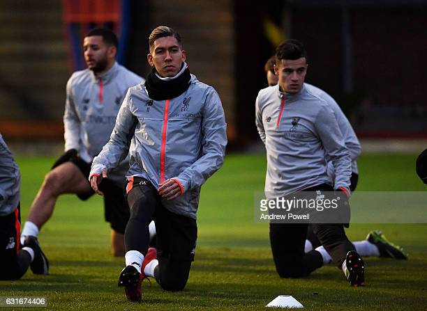 Roberto Firmino and Philippe Coutinho of Liverpool during a training session at Melwood Training Ground on January 14 2017 in Liverpool England