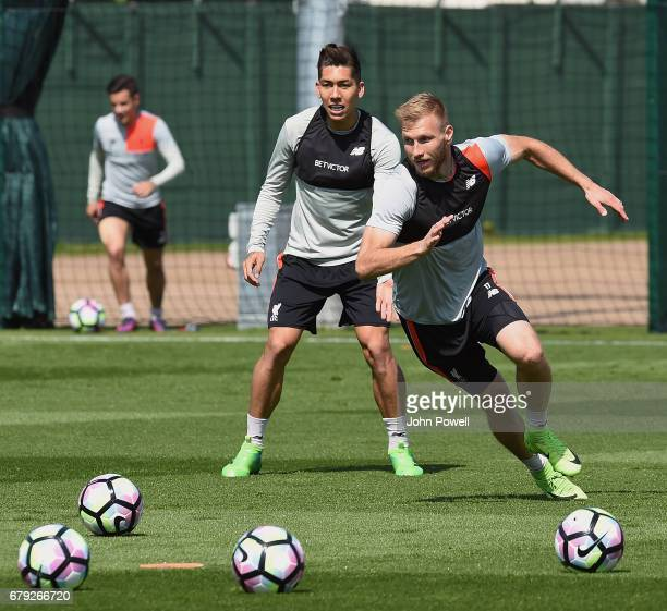 Roberto Firmino and Ragnar Klavan of Liverpool during a training session at Melwood Training Ground on May 5 2017 in Liverpool England