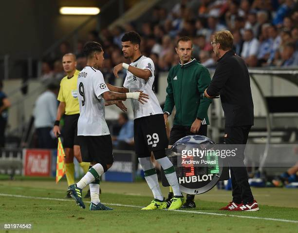 Roberto Firmino Goes off as Dominic Solanke comes on for Liverpool during the UEFA Champions League Qualifying PlayOffs Round First Leg match between...