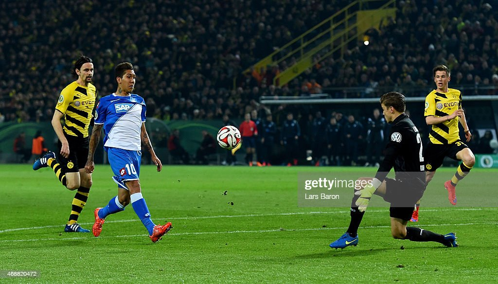 Roberto Firmino of 1899 Hoffenheim scores his teams second goal past goalkeeper Mitchell Langerak of Borussia Dortmund during the DFB Cup Quarter Final match between at Borussia Dortmund and 1899 Hoffenheim at Signal Iduna Park on April 7, 2015 in Dortmund, Germany.