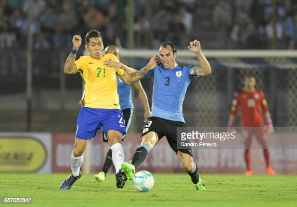 Roberto Firmino of Brazil and Diego Godin of Uruguay fight for the ball during a match between Uruguay and Brazil as part of FIFA 2018 World Cup...