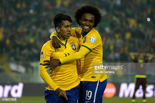 Roberto Firmino of Brazil celebrates with teammate Willian after scoring the second goal of his team during the 2015 Copa America Chile Group C match...