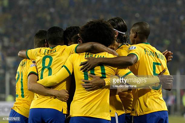 Roberto Firmino of Brazil celebrates with teammates after scoring the second goal of his team during the 2015 Copa America Chile Group C match...