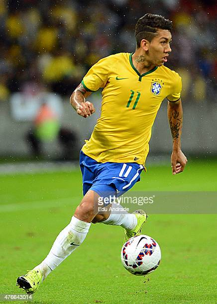 Roberto Firmino of Brazil drives the ball during the international friendly match between Brazil and Honduras at Beira Rio Stadium on June 10 2015 in...