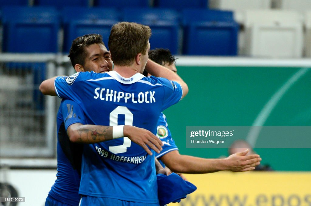 <a gi-track='captionPersonalityLinkClicked' href=/galleries/search?phrase=Roberto+Firmino&family=editorial&specificpeople=7522629 ng-click='$event.stopPropagation()'>Roberto Firmino</a> of Hoffenheim celebrates after scoring his teams second goal during the DFB Cup second round match between TSG 1899 Hoffenheim and FC Energie Cottbus at Wirsol Rhein-Neckar-Arena on September 24, 2013 in Sinsheim, Germany.