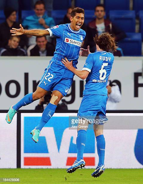 Roberto Firmino of Hoffenheim celebrates his team's first goal with team mate Sebastian Rudy during the Bundesliga match between 1899 Hoffenheim and...