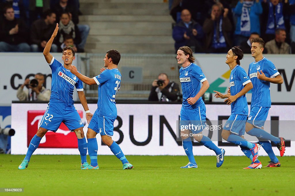 Roberto Firmino of Hoffenheim celebrates his team's first goal with team mates Kevin Volland Sebastian Rudy Takashi Usami and Joselu during the...