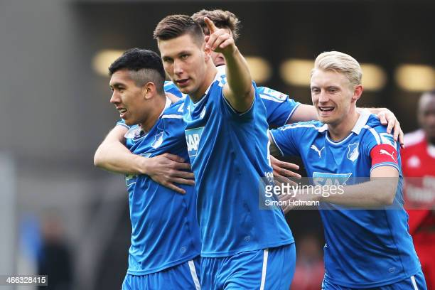 Roberto Firmino of Hoffenheim celebrates his team's first goal with his team mates Niklas Suele and Andreas Beck during the Bundesliga match between...