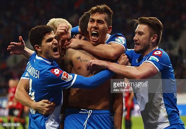 Roberto Firmino of Hoffenheim celebrates scoring the winning goal with teamates during the Bundesliga match between 1899 Hoffenheim and Eintracht...