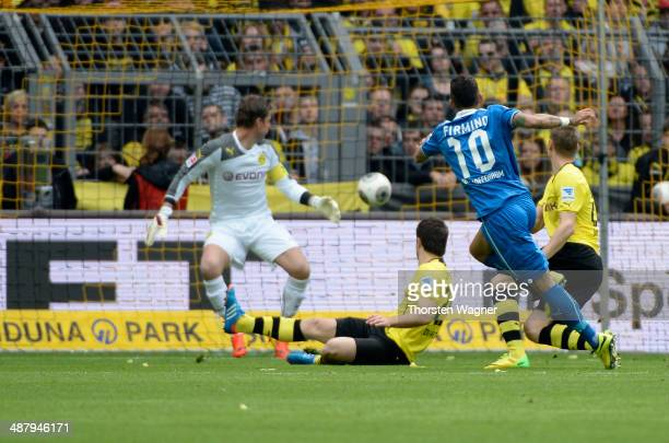 Roberto Firmino of Hoffenheim is scoring his teams opening goal during the Bundesliga match between Borussia Dortmund and TSG 1899 Hoffenheim at...