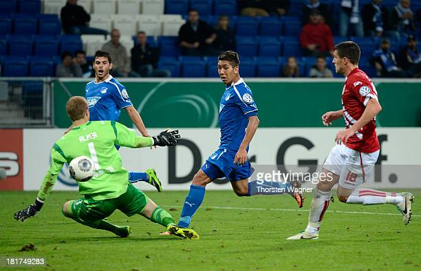 Roberto Firmino of Hoffenheim is scoring his teams second goal during the DFB Cup second round match between TSG 1899 Hoffenheim and FC Energie...