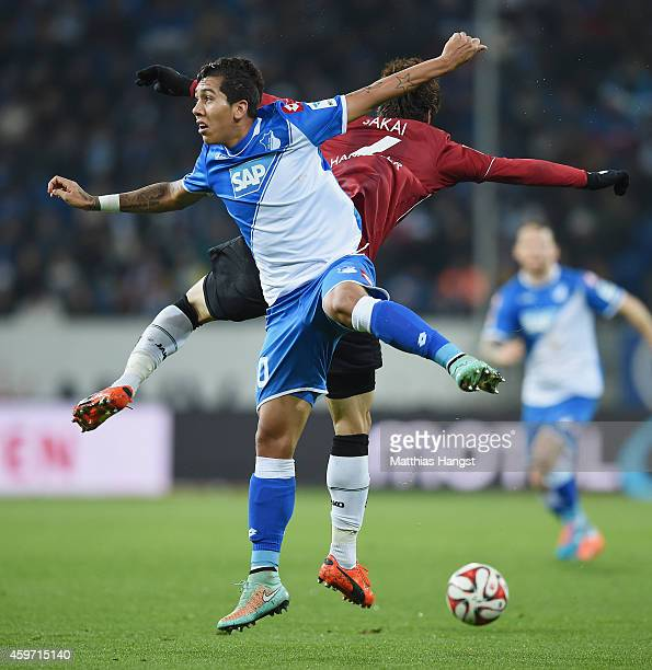 Roberto Firmino of Hoffenheim jumps for a header with Hiroki Sakai of Hannover during the Bundesliga match between 1899 Hoffenheim and Hannover 96 at...