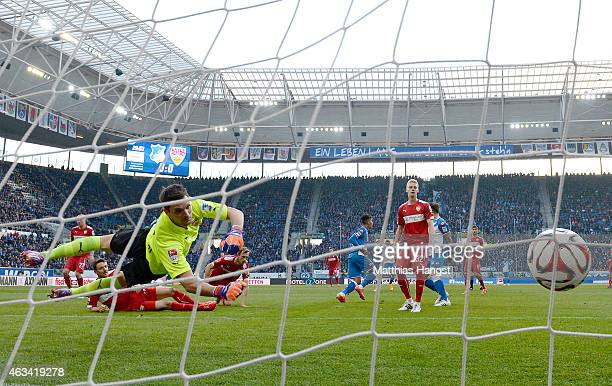 Roberto Firmino of Hoffenheim scores his team's first goal past goalkeeper Sven Ulreich of Stuttgart during the Bundesliga match between 1899...