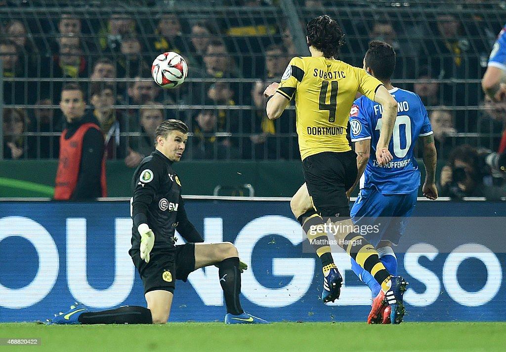 Roberto Firmino of Hoffenheim scores his team's second goal past goalkeeper Mitchell Langerak of Dortmund during the DFB Cup Quarter Final match...