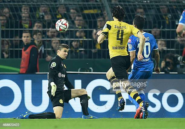 Roberto Firmino of Hoffenheim scores his team's second goal past goalkeeper Mitchell Langerak of Dortmund during the DFB Cup Quarter Final match...