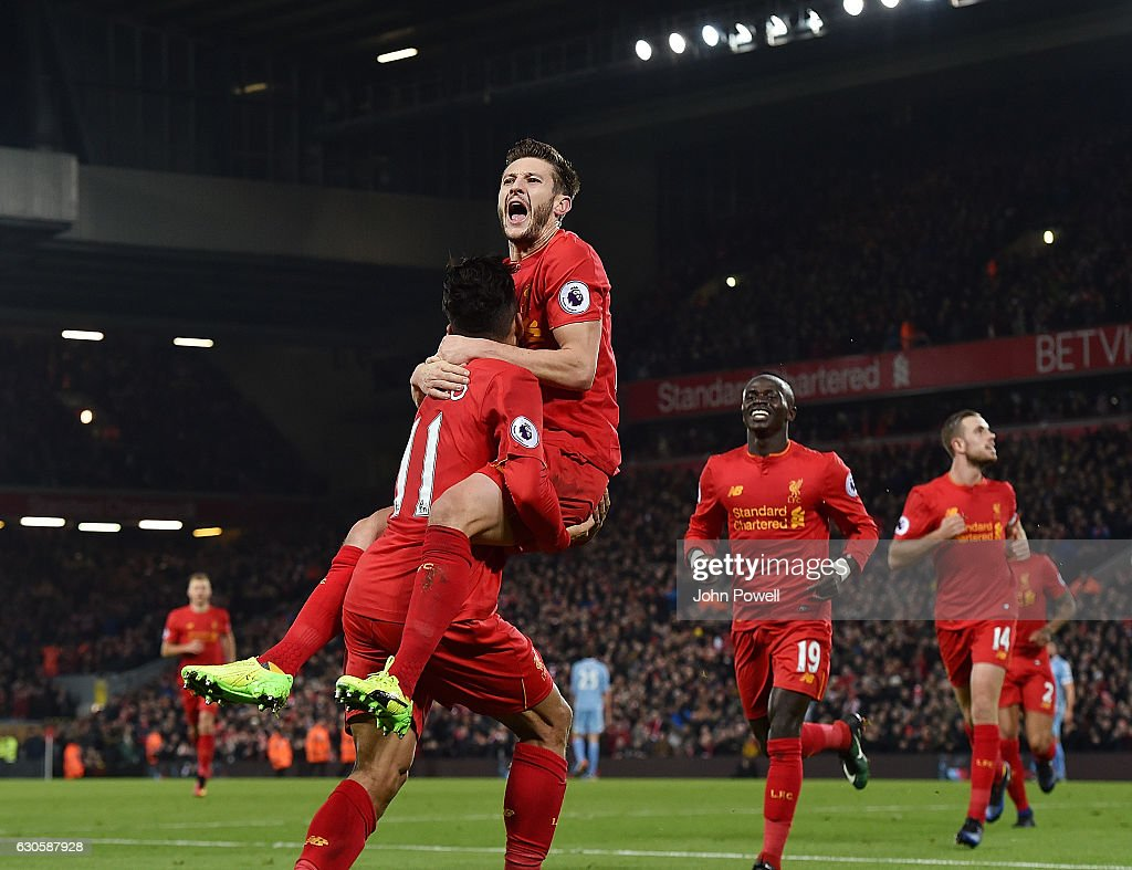 Roberto Firmino of Liveprool celebrates after scoring during the Premier League match between Liverpool and Stoke City at Anfield on December 27, 2016 in Liverpool, England.