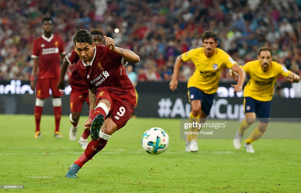 Roberto Firmino of Liveprool scores from the penalty spot to equalise during the Audi Cup 2017 match between Liverpool FC and Atletico Madrid at Allianz Arena on August 2, 2017 in Munich, Germany.