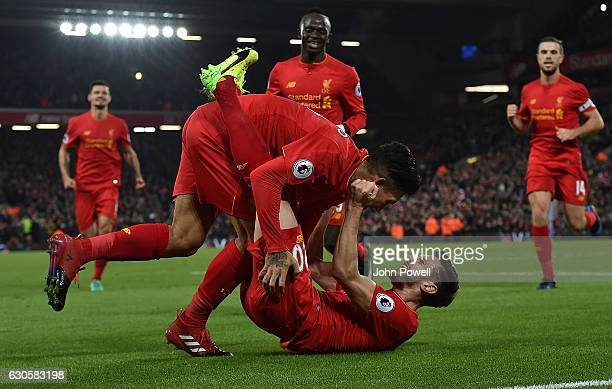 Roberto Firmino of Liveprool Scores The Second for his team and Celebrates during the Premier League match between Liverpool and Stoke City at...