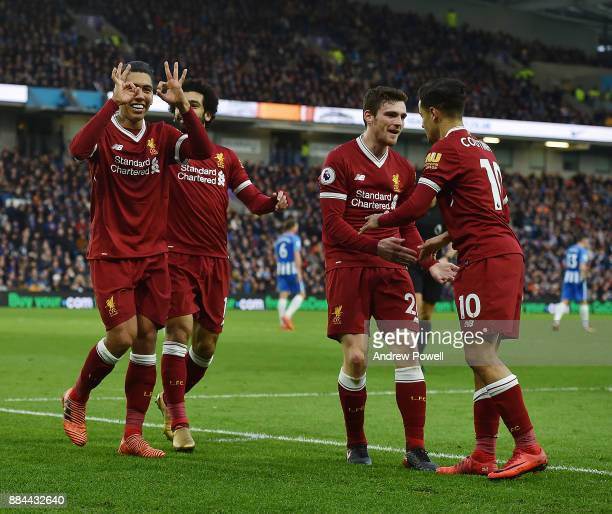 Roberto Firmino of Liverpol Celebrates the second goal during the Premier League match between Brighton and Hove Albion and Liverpool at Amex Stadium...