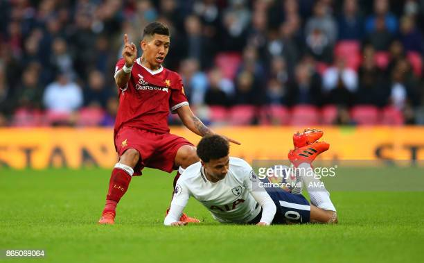 Roberto Firmino of Liverpool and Dele Alli of Tottenham Hotspur during the Premier League match between Tottenham Hotspur and Liverpool at Wembley...