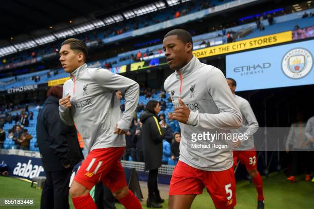 Roberto Firmino of Liverpool and Georginio Wijnaldum of Liverpool come out of the tunnel to warm up prior to the Premier League match between...