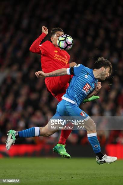 Roberto Firmino of Liverpool and Harry Arter of AFC Bournemouth during the Premier League match between Liverpool and AFC Bournemouth at Anfield on...