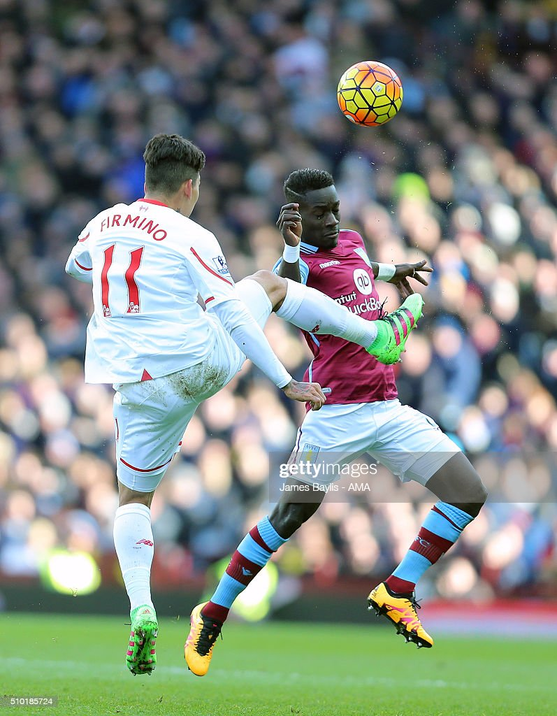 Roberto Firmino of Liverpool and Idrissa Gueye of Aston Villa during the Barclays Premier League match between Aston Villa and Liverpool at Villa Park on February 14, 2016 in Birmingham, England.