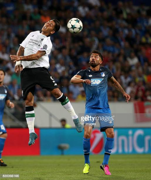 Roberto Firmino of Liverpool and Kerem Demirbay of Hoffenheim battle for the ball during the UEFA Champions League Qualifying PlayOffs Round First...